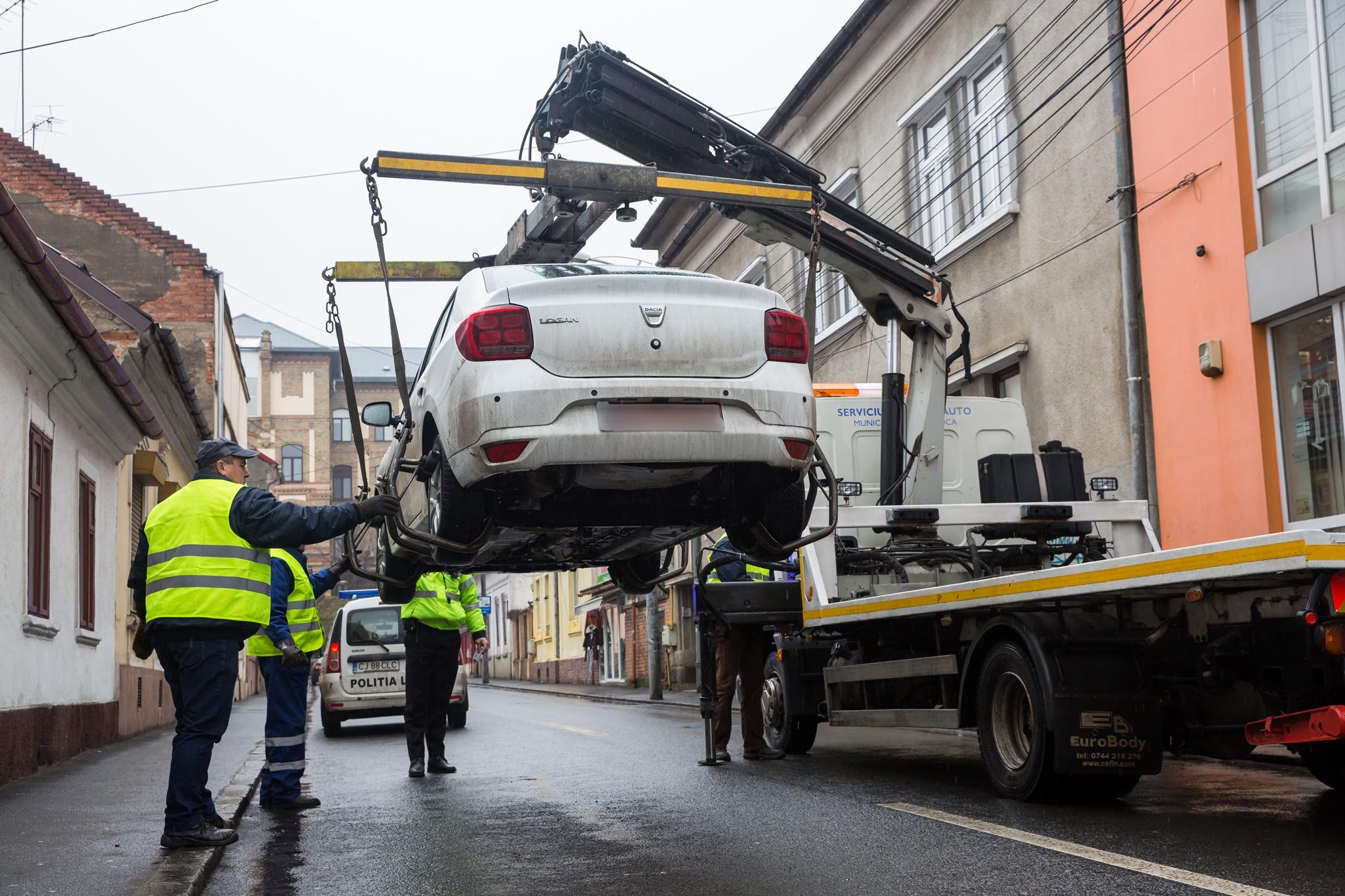 Cei implicati in ridicarea masinilor risca amenzi substantiale daca nu respecta anumite tarife