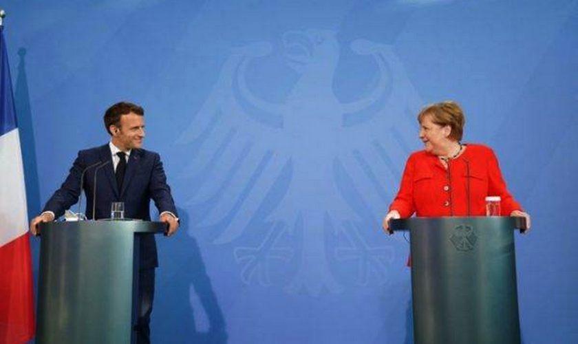 Noi restricții de călătorie în Europa?! Angela Merkel și Emmanuel Macron îi critică pe greci