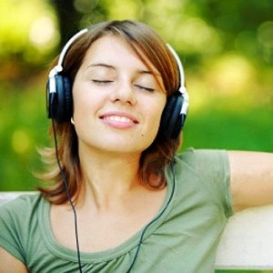 relaxed-young-woman-listening-music