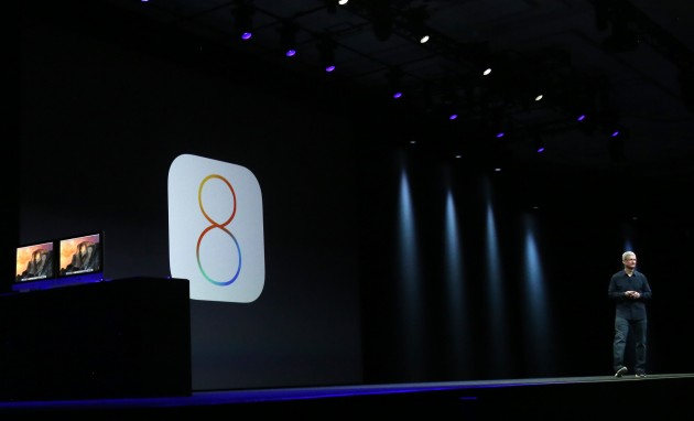 Apple CEO Tim Cook introduces the IOS 8 operating system during his keynote address at the Worldwide Developers Conference in San Francisco, California