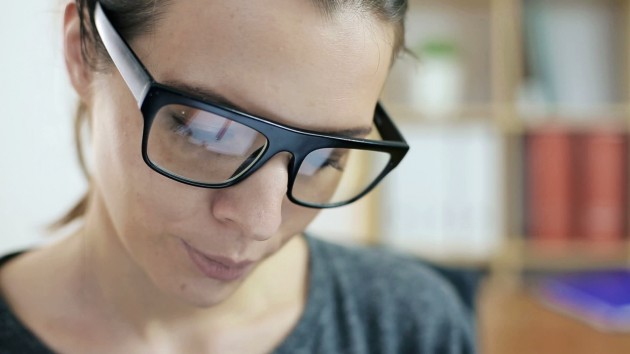 stock-footage-businesswoman-watching-something-on-tablet-computer-in-the-office