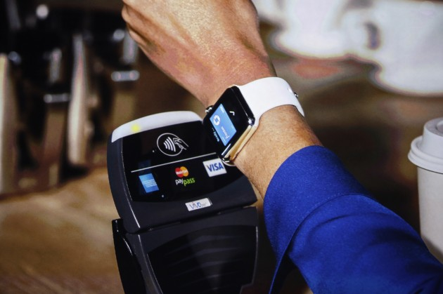 An Apple Watch is shown making a tap transaction during an Apple event at the Flint Center in Cupertino