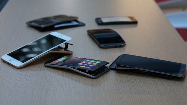 Consumer Reports _Electronics_Bent_Phones_Scattered_09-14