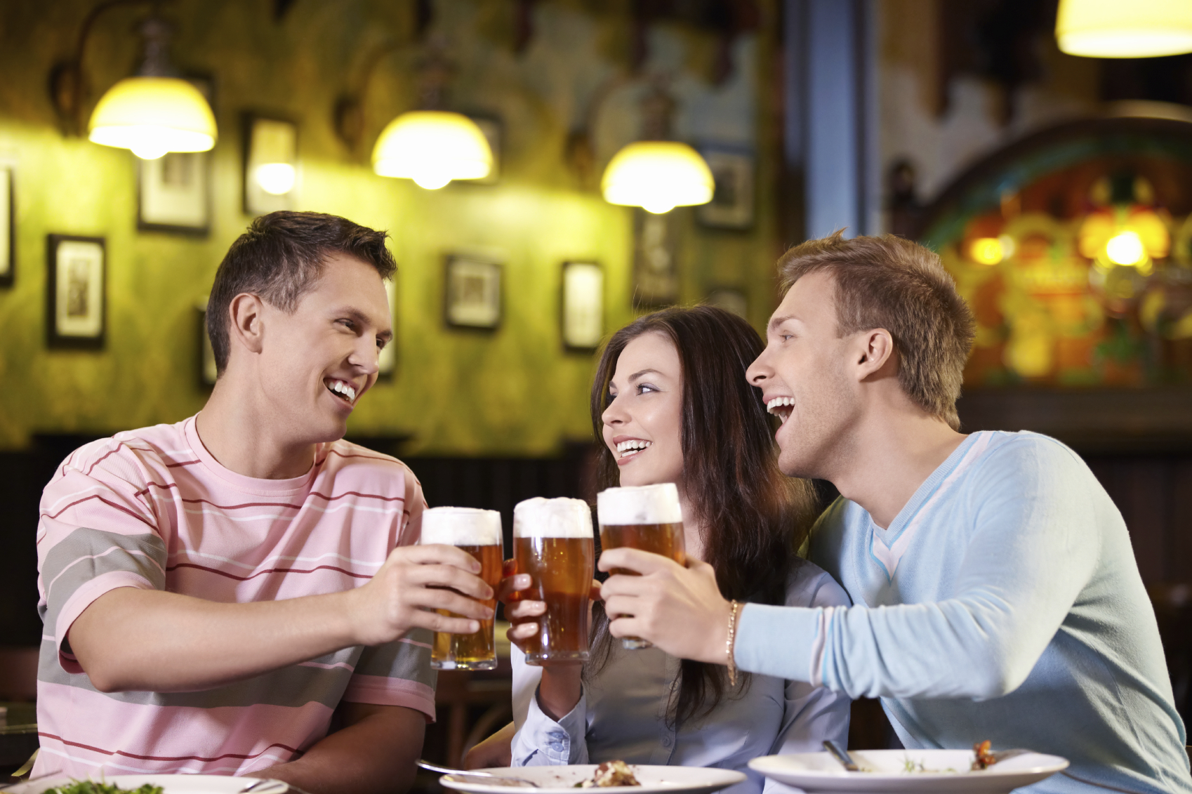 Young people with a beer in a restaurant