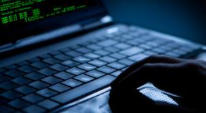 Trei hackeri români, acuzați de fraudă în America